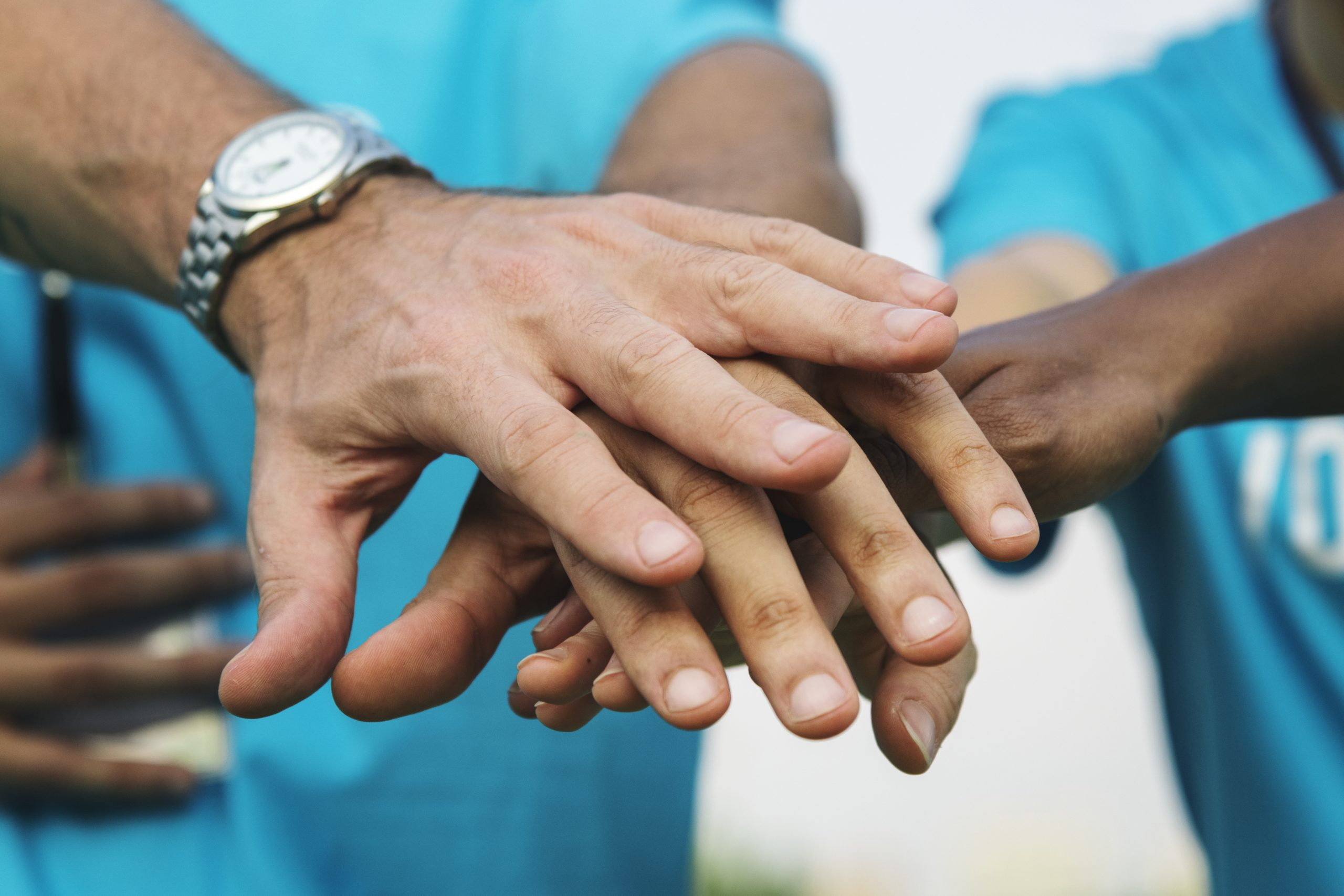 diverse hands stacked in agreement